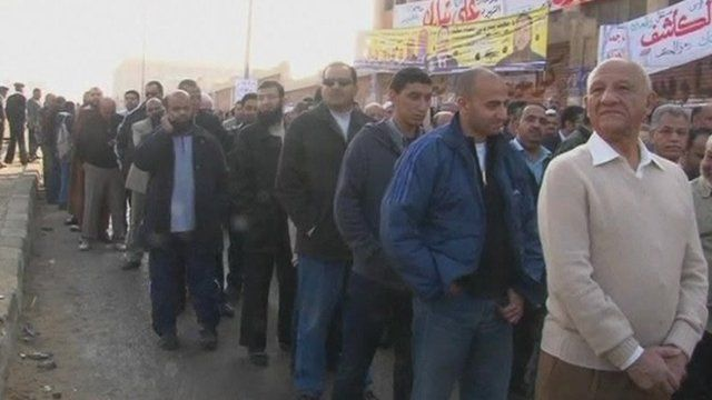 Egyptians queue at a polling station
