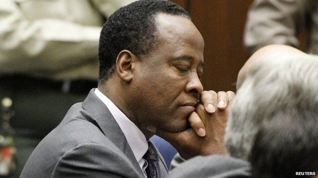 Dr. Conrad Murray closes his eyes after he was sentenced to four years