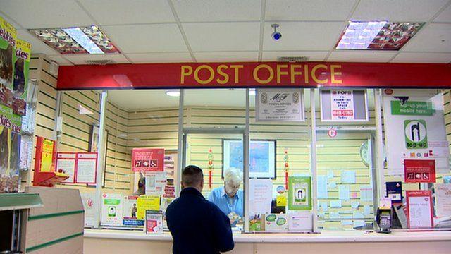 Man at a post office counter