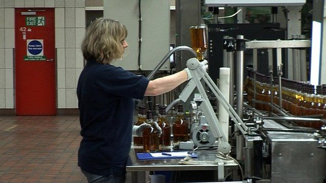 Woman working in a whisky bottling plant
