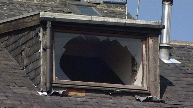A broken window in an empty house