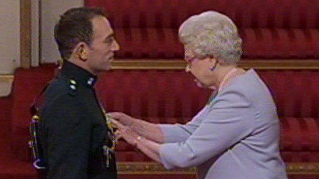 Lt Paul McFarland receives the Military Cross from The Queen