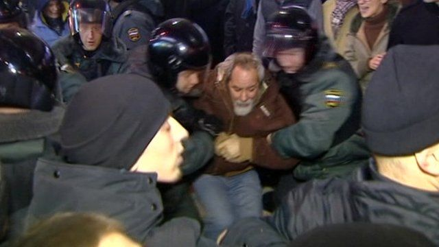 Security forces holding a protester