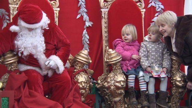 Two children in Santa's grotto in York
