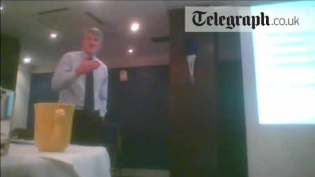 Still from footage which appears to show an examiner advising what questions can be expected. courtesy Daily Telegraph
