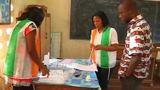Election volunteers at a polling station in Ivory Coast