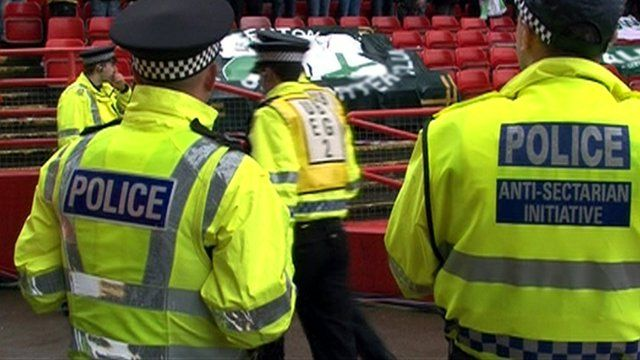 Police wearing anti-sectarian initiative jackets at a football ground