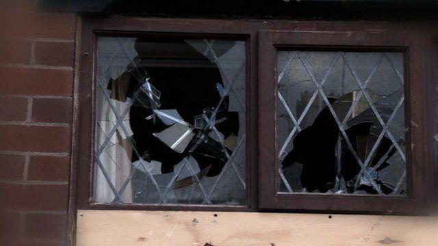 Windows of house smashed inwards