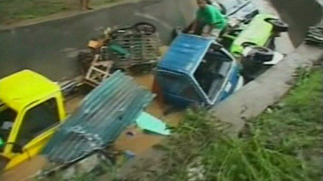 Vehicles left capsized by the floods.