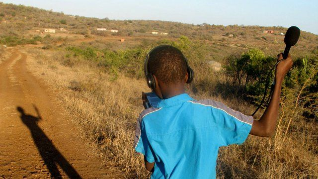 A boy with recording equipment. Photo: Children's Radio Foundation