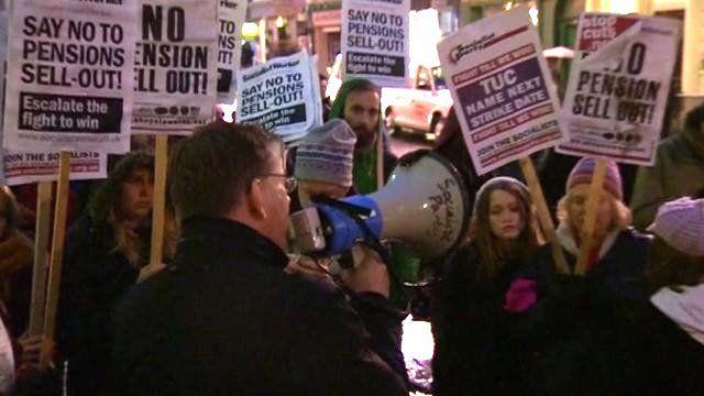 Man addressing demonstrators at rally