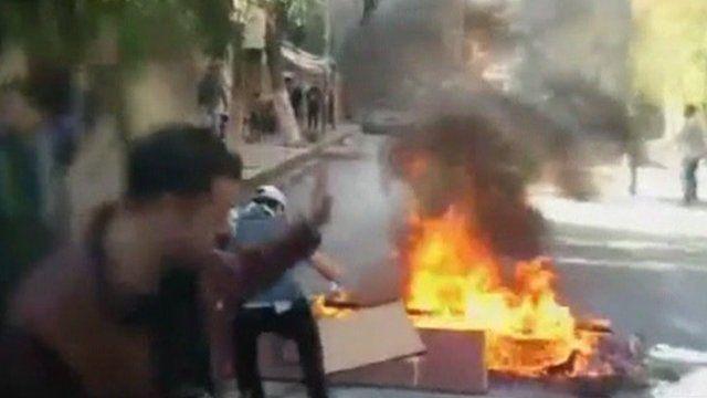 Burning rubbish in street