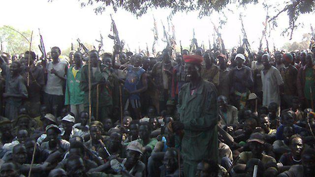 Armed Lou Nuer men listen to South Sudan's Vice-President Riek Machar - 28 December 2011.