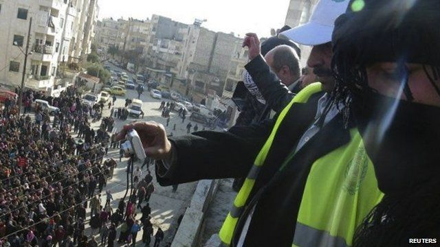 Arab League observers taking photos of anti-government protesters in Syria