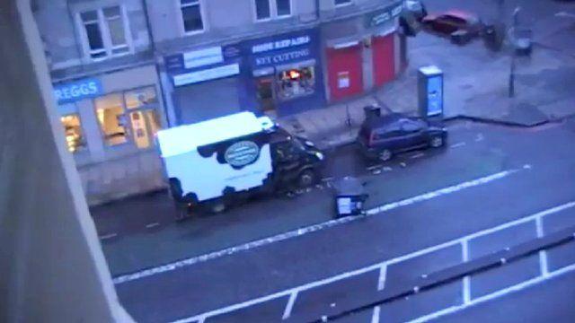 An overturned wheelie bin in the street