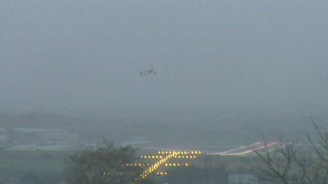 Plane hovers above the runway in an abortive landing at Aberdeen Airport.
