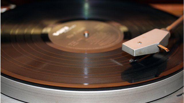 An album playing on a record player