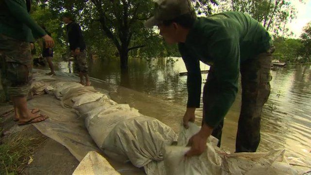 Sandbags laid out along a river during Thailand's flooding last year
