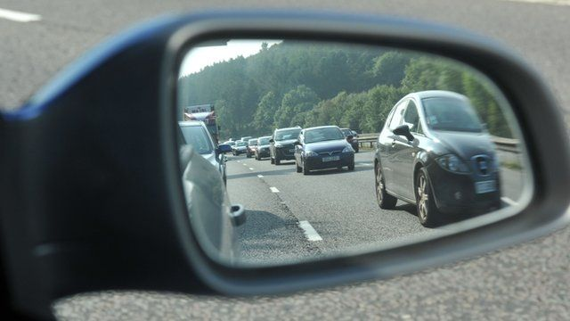 Traffic jam viewed from a car wing mirror