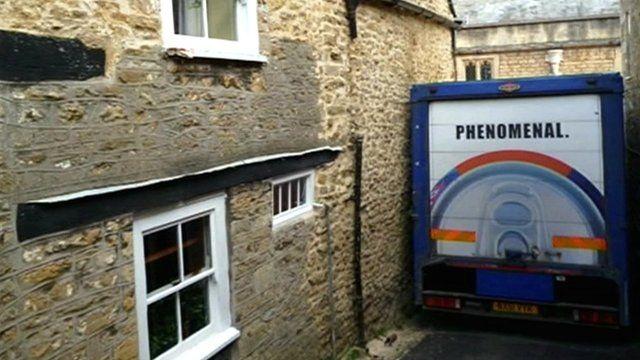 Lorry stuck in narrow road