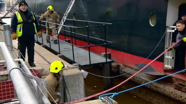 Firemen working at the Royal Yacht Britannia