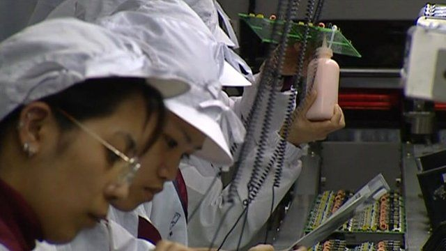 Workers in Taiwanese electronics factory