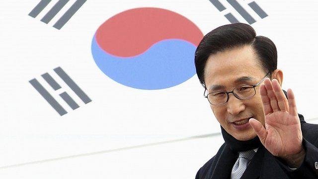 South Korean President Lee Myung-bak waves before leaving for China at Seoul military airport, South Korea
