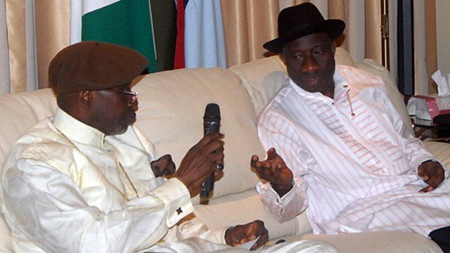 Pastor Ayo Oritsejafor speaks with Nigerian President Goodluck Jonathan during a meeting in the State House in Abuja on December 28, 2011