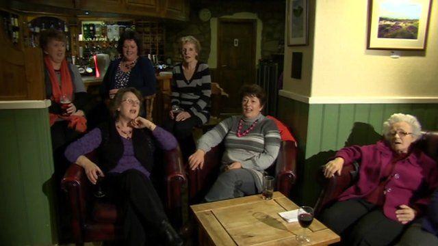 Women singing in a pub