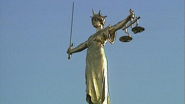 Courts of Justice statue
