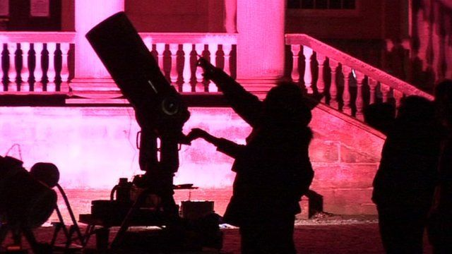 Silhouette of a man and a telescope