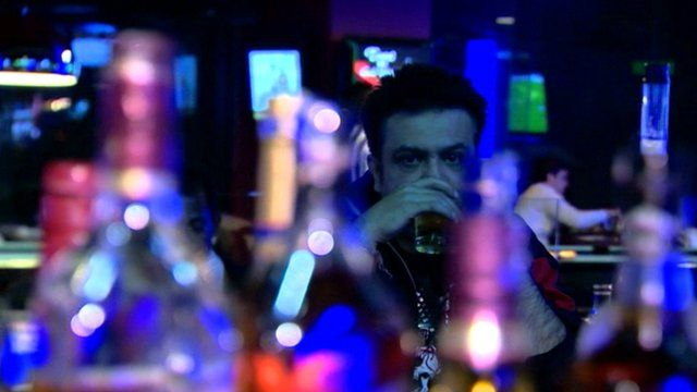 Man drinking in a bar in India