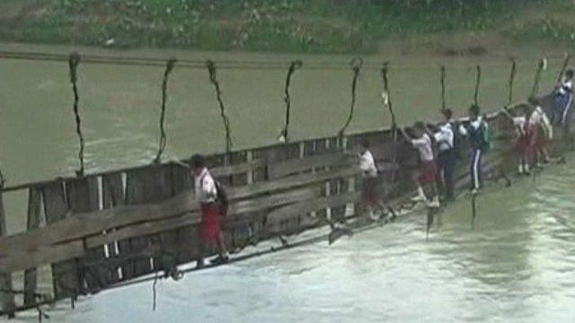 Children crossing the bridge