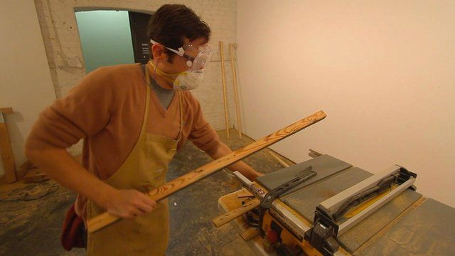 Man working with lumber