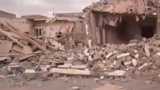Damaged buildings in Zinjibar