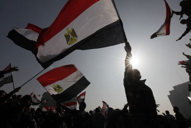 Egyptians mark the one year anniversary of the uprising on Tahrir Square