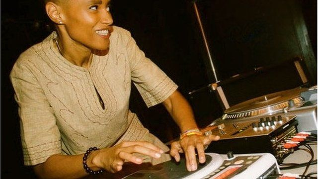 Woman at DJ turntables