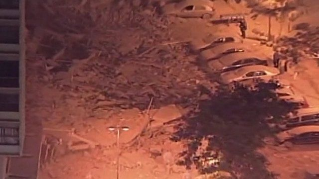 Aerial shot of rubble covering cars