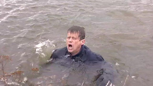 Mike Bushell pulls a face while splashing to get out of cold water.