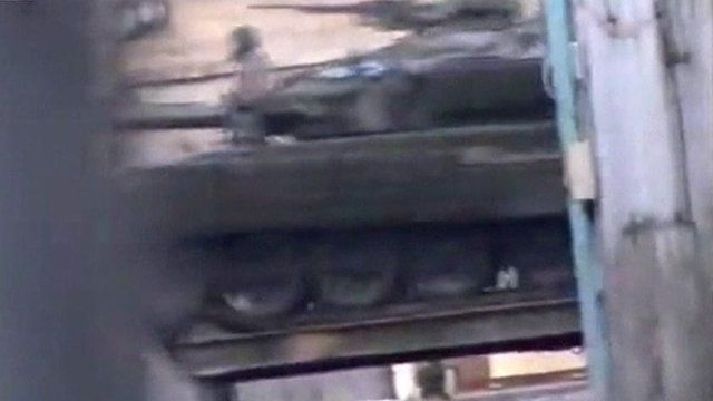 Unverified image of a tank moving towards the centre of Damascus.