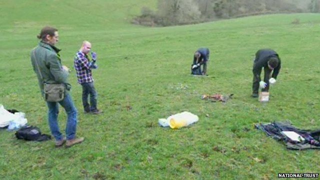 Investigators taking samples from a deer
