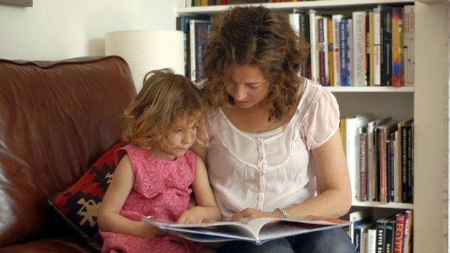 Mother reading to her child