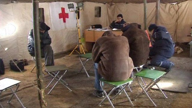 People in heated tent in Ukraine