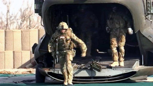 Soldiers disembark a Chinook in Afghanistan