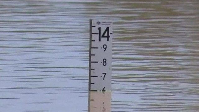 A ruler measuring the floodwater