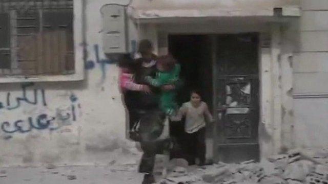 Man with three children fleeing a building