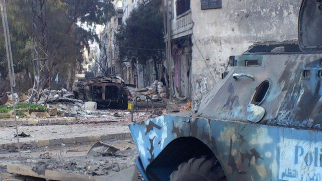Burnt-out tank in Homs