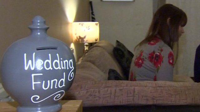 """A money box marked 'Wedding fund"""""""
