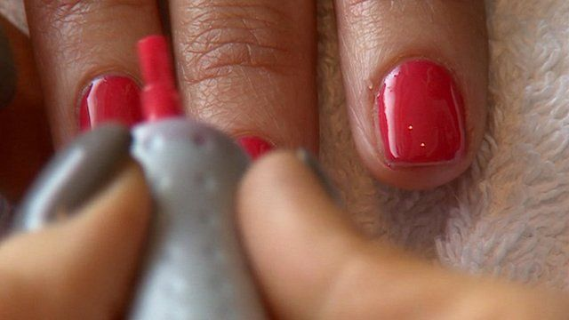 Finger nails being painted