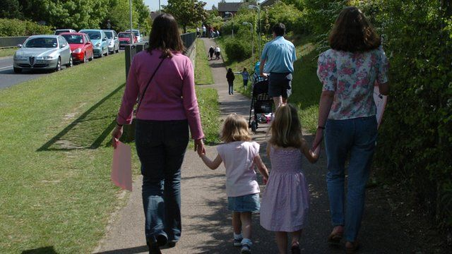 mothers walking their children home from nursery
